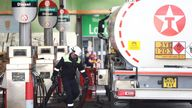A tanker driver delivers fuel to a Texaco petrol station in London, Britain, October 4, 2021. REUTERS/Henry Nicholls