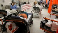 """Medical professionals assist coronavirus disease (COVID-19) patients in the overcrowded intensive care unit at the Emergency Hospital """"Bagdasar-Arseni"""", in Bucharest, Romania, October 19, 2021"""