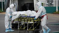 Medical specialists transport a patient outside a hospital for people infected with the coronavirus disease