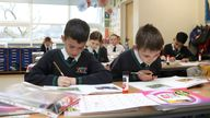 """File photo dated 08/03/21 of children in the classroom at school. The Government's rhetoric on """"levelling up"""" and the importance of education must be backed up with action, a school leaders' union chief will urge in a speech on Friday at the NAHT union's conference in London."""