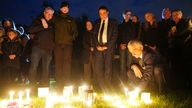 People during a candlelight vigil at Belfairs Recreation Ground near to Belfairs Methodist Church in Eastwood Road North, Leigh-on-Sea, Essex, where Conservative MP Sir David Amess died after he was stabbed several times at a constituency surgery on Friday. Picture date: Saturday October 16, 2021.
