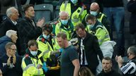Dr Tom Prichard is seen at the front as the fan is taken on a stretcher