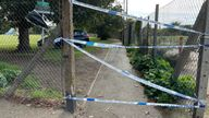 Police tape blocks the entrance to a playing field in Craneford Way, Twickenham, south-west London, where an 18-year-old was stabbed on Tuesday afternoon. The teenager was taken to hospital but was pronounced dead just over an hour later. Picture date: Wednesday October 13, 2021.