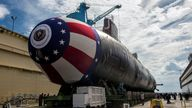 The Virginia-class attack submarine Pre-commissioning Unit (PCU) John Warner (SSN 785) is moved to Newport News Shipbuilding's floating dry dock in preparation for the September 6 christening in Newport News, Virginia, U.S. August 31, 2014. To match Special Report CHINA-CYBER/CLOUDHOPPER U.S. Navy/John Whalen/Huntington Ingalls Industries/Handout via REUTERS ATTENTION EDITORS - THIS IMAGE WAS PROVIDED BY A THIRD PARTY.