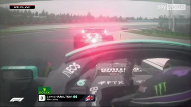 Hamilton goes round the outside of Tsunoda