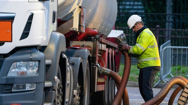 A tanker driver makes a fuel delivery at a petrol station in south London. Picture date: Monday October 4, 2021.