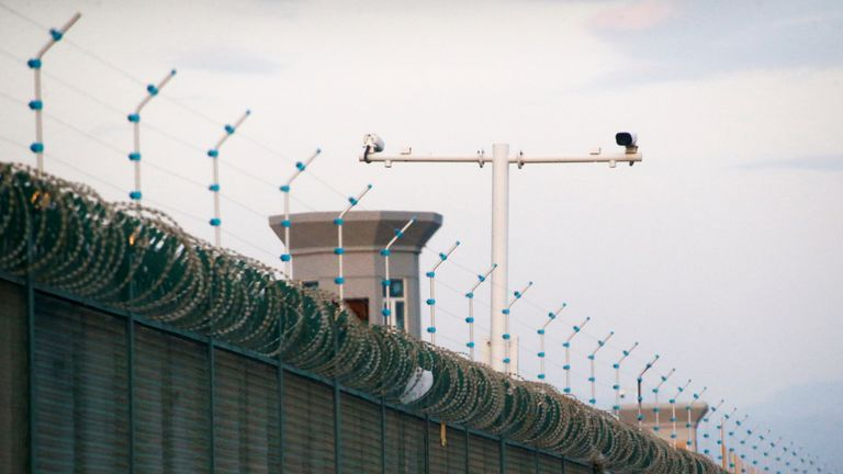 Security cameras are installed above the perimeter fence of what is officially known as a vocational skills education centre in Dabancheng, in Xinjiang Uighur Autonomous Region, China September 4, 2018. This centre, situated between regional capital Urumqi and tourist spot Turpan, is among the largest known ones, and was still undergoing extensive construction and expansion at the time the photo was taken. Picture taken September 4, 2018. To match Special Report MUSLIMS-CAMPS/CHINA  REUTERS/Thomas Peter