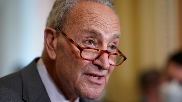 """Senate Majority Leader Chuck Schumer, D-N.Y., speaks to reporters after a Democratic policy meeting at the Capitol in Washington, Tuesday, Oct. 5, 2021. President Joe Biden is urging Republican senators to """"get out of the way"""" and let Democrats suspend the nation's debt limit to keep the U.S. government from getting dangerously close to a devastating credit default. (AP Photo/J. Scott Applewhite)"""