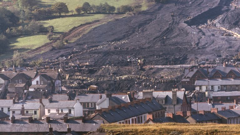 ABERFAN : 1966. .ABERFAN 1966: The moving mountain of coal sludge after the disaster at Aberfan when the coal tip avalanched through the Pantglas Junior School, killing 116 children and 28 adults.. .Picture by: PA..Copyright: PA Archive/Press Association Images..Date: 27/10/1966