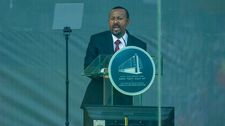 Ethiopia's Prime Minister Abiy Ahmed speaks behind bulletproof glass at his inauguration ceremony on 4 October