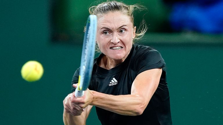 Alaksandra Sasnovich returns a shot to Emma Raducanu at the BNP Paribas Open tennis tournament Friday Oct. 8, 2021, in Indian Wells, Calif. (AP Photo/Mark J. Terrill)