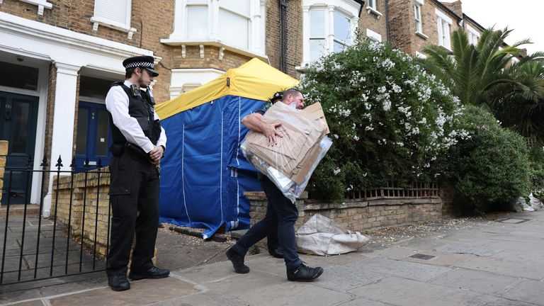 Police remove items from property in north London