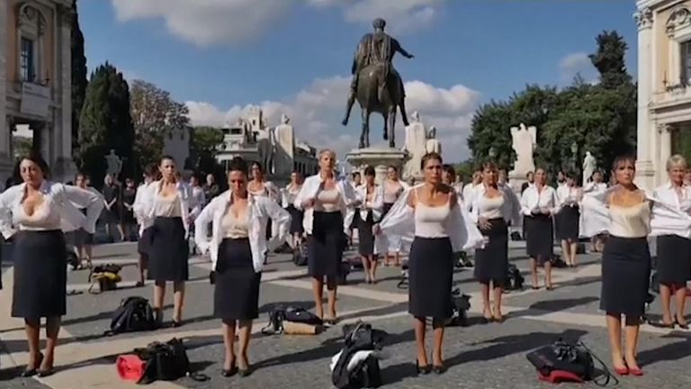 Dozens of former flight attendants from defunct Italian airline Alitalia stripped off their uniforms wearing only undergarments in a protest against job cuts