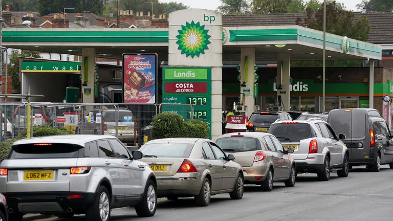 Vehicles queue up outside a BP petrol station in Alton, Hampshire. Picture date: Thursday September 30, 2021.