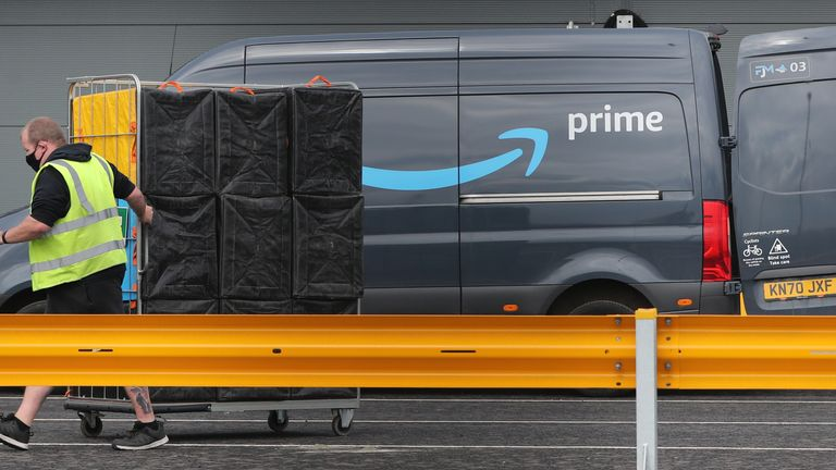 Electric delivery vans are packed at the Amazon warehouse in the Titanic Quarter, Belfast. Picture date: Wednesday April 21, 2021.