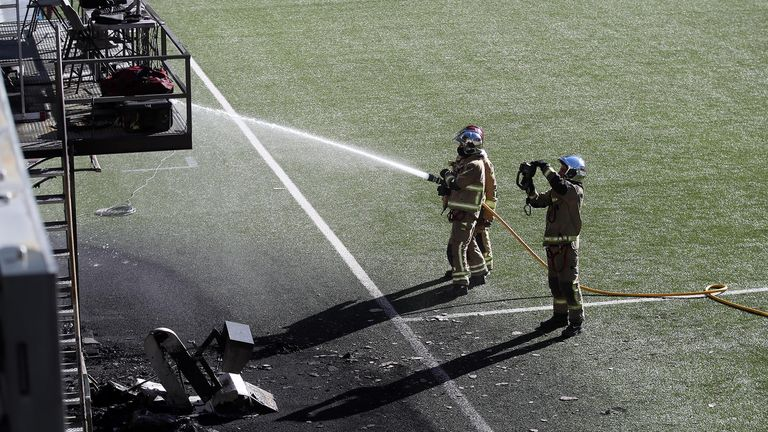 Soccer Football - World Cup - UEFA Qualifiers - England Training - Estadi Nacional, Andorra La Vella, Andorra - October 8, 2021 Firefighters are seen using a hose near a VAR monitor that was burnt in a fire after training Action Images via Reuters/Carl Recine