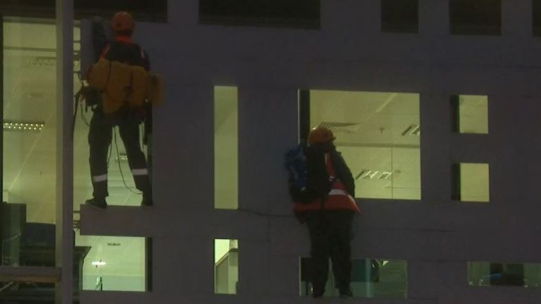 Animal Rebellion protesters scale the Home Office building