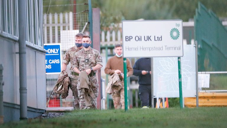 Members of the military walk at Buncefield Oil Depot in Hemel Hempstead, Britain, October 4, 2021. REUTERS/Andrew Boyers