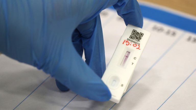 People carry out asymptomatic testing using lateral flow antigen