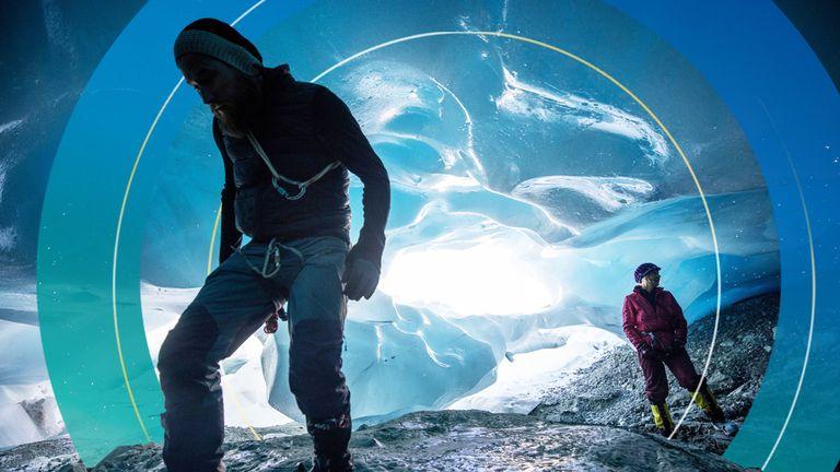 Andrea Fischer and Martin Stocker-Waldhuber explore a natural glacier cavity of the Jamtalferner glacier