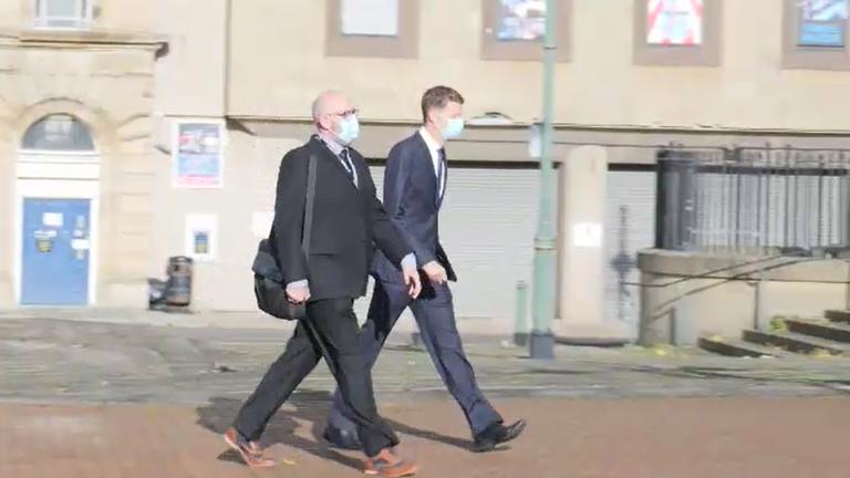 Police officer Ben Lister walks Bradford Crown Court on Monday.