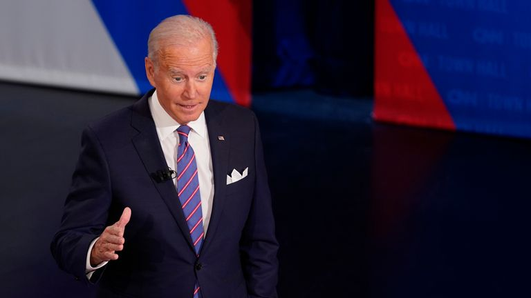 President Joe Biden participates in a CNN town hall at the Baltimore Center Stage Pearlstone Theater, Thursday, Oct. 21, 2021, in Baltimore, with moderator Anderson Cooper. (AP Photo/Evan Vucci) Pic: AP
