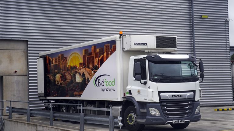 """A BidFood lorry, as the company placed an advert for lorry drivers outside their warehouse in Slough, Berkshire. BidFood, one of the UK's largest food wholesalers, which delivers to schools, told ITV News they are experiencing """"significant pressures across the supply chain, including shortages from manufacturers and challenges with HGV driver recruitment, which in turn is impacting our ability to deliver our usual levels of service out of a portion of our depots"""". Picture date: Friday October 8,"""