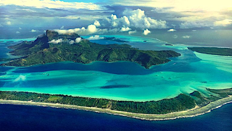Stunning view of Bora Bora Island just before landing there. French Polynesia, South Pacific Ocean.
