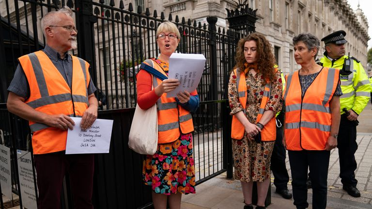 Members of Insulate Britain attempt to hand in a letter for Boris Johnson at 10 Downing Street