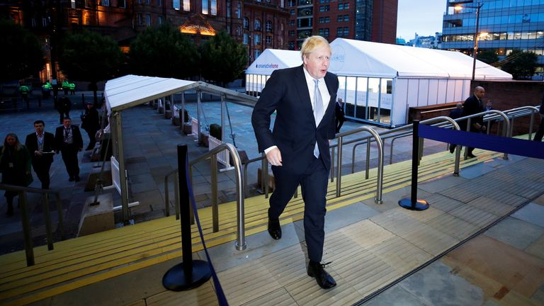 Britain's Prime Minister Boris Johnson walks to the conference venue ahead of the annual Conservative Party conference, in Manchester, Britain, October 5, 2021. REUTERS/Phil Noble