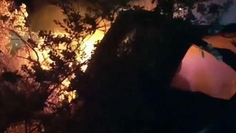 Police drag man from burning car in Texas