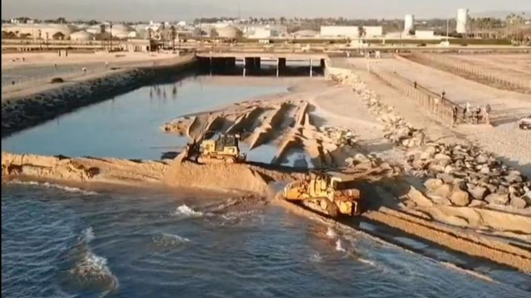 Authorities Rush to Protect Wetlands as Oil Spill Washes Up on Huntington Beach, California