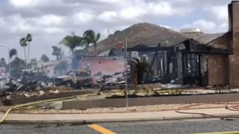 The scene of a plane crash in a residential street in San Diego