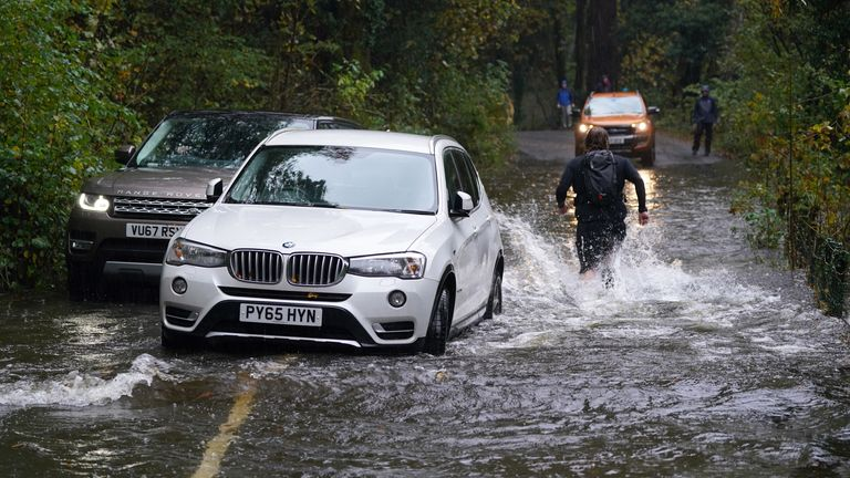 """A broken down car in floodwater near Derwentwater, Keswick in Cumbria, where the Met office has warned of life-threatening flooding and issued amber weather warnings as the area was lashed with """"persistent and heavy rain"""". Up to 300mm is expected to fall in parts of the region, which typically sees an average of 160mm in October. Picture date: Thursday October 28, 2021."""