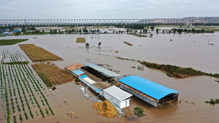 In this photo released by Xinhua News Agency, an aerial photo shows an overflowing Yellow River near Lianbo Village in Hejin City in northern China's Shanxi Province on Sunday, Oct. 10, 2021 PIC:AP