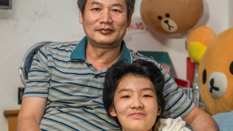 Huang Chong and her father Huang Wen Shang are pictured together as they discuss the gaming rules in China