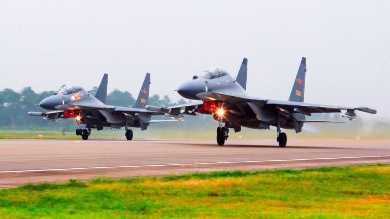 Two Chinese SU-30 fighter jets take off from an unspecified location to fly a patrol over the South China Sea. Pic: AP