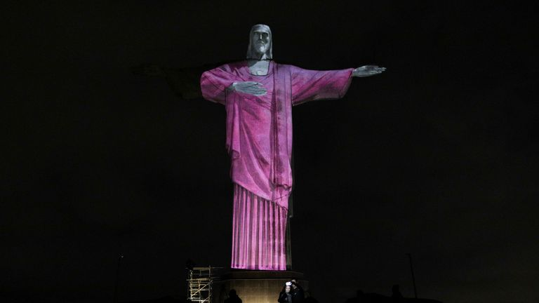 The Christ the Redeemer statue is pictured as an image is projected to mark Breast Cancer Awareness Month in Rio de Janeiro, Brazil, October 22, 2021. REUTERS/Ricardo Moraes