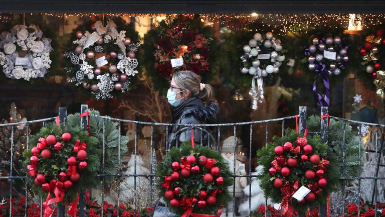 PABest A person wearing a face covering walks passed Christmas wreaths for sale at All Occasions Designer florist in Denny. Eleven local council areas in Scotland are under Level 4 restrictions to slow the spread of coronavirus.