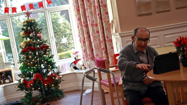 A resident speaks to his family via Zoom from Alexander House Care Home on Christmas Day, as the spread of the coronavirus disease (COVID-19) continues in Wimbledon, London, Britain, December 25, 2020. Picture taken December 25, 2020. REUTERS/Hannah McKay