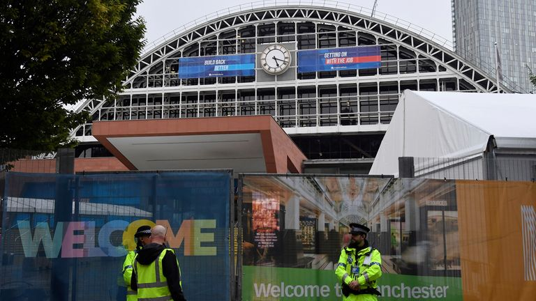 Police officers and security staff patrol outside of the Manchester Central Convention Complex at the annual Conservative party conference in Manchester, Britain, October 2, 2021. REUTERS/Toby Melville