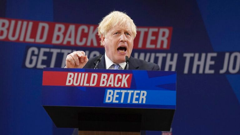 Britain's Prime Minister Boris Johnson gestures as he makes his keynote speech at the Conservative party conference in Manchester