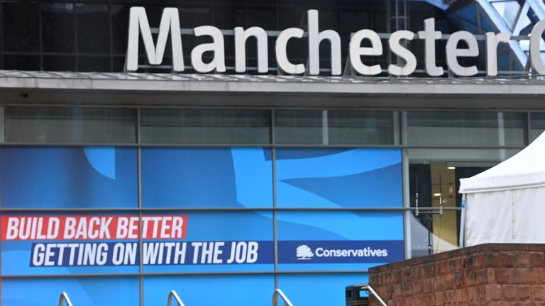 A security officer patrols outside of the Manchester Central Convention Complex at the annual Conservative party conference in Manchester