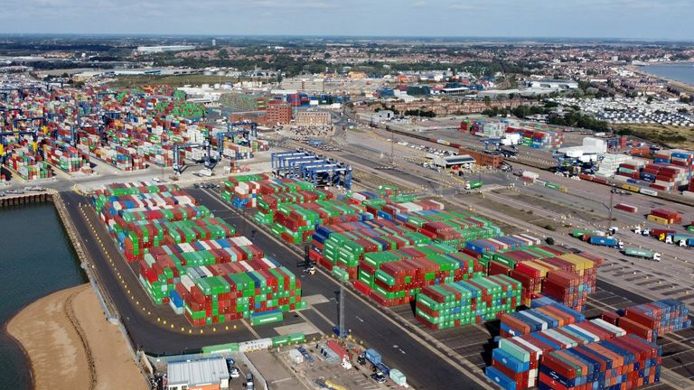 A view shows stacked shipping containers at the port of Felixstowe, Britain, October 13, 2021. Picture taken with a drone. REUTERS/Hannah McKay