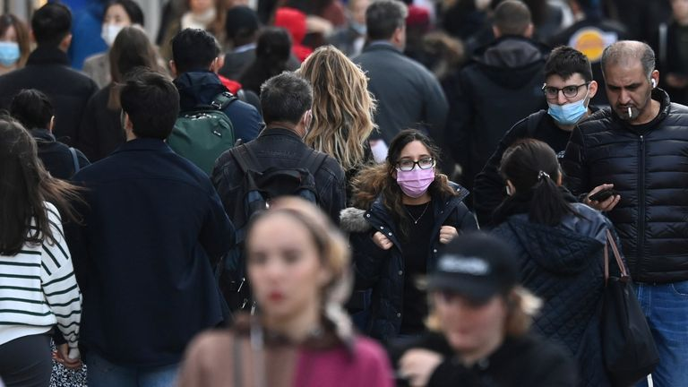 Shoppers, some wearing masks, walk along Oxford Street amidst the spread of the coronavirus disease (COVID-19) pandemic, in London, Britain, October 20, 2021. REUTERS/Toby Melville