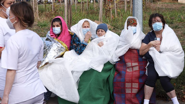 Patients sit wrapped in blankets and sheets after a fire in the COVID-19 ICU section of the Hospital for Infectious Diseases in the Black Sea port of Constanta, Romania, Friday, Oct. 1, 2021. Authorities say a fire at a hospital in Romania's port city of Constanta has killed nine COVID-19 patients in the ICU. All patients have been evacuated following Friday's blaze at Constanta's Hospital for Infectious Diseases. (AP Photo/Costin Dinca) PIC:AP