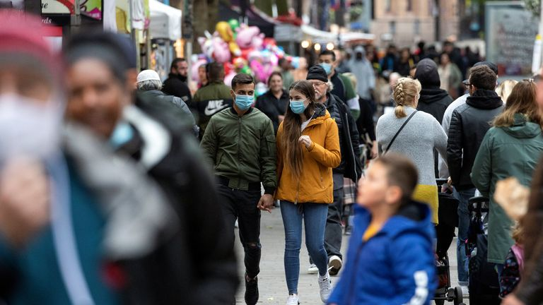 Pedestrians walk on the High Street, amid the spread of the coronavirus disease (COVID-19), in Croydon, south London, Britain, September 27, 2020. REUTERS/Simon Dawson