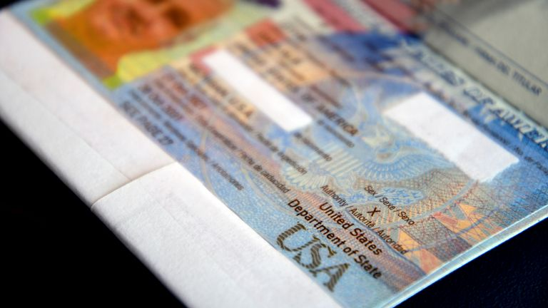 """A passport belonging to Dana Zzyym rests on a table, Wednesday, Oct. 27, 2021, in Fort Collins, Colo. Zzyym, who prefers a gender-neutral pronoun, told the Associated Press that their passport is the first U.S. passport to be issued with an """"X"""" gender designation, marking a milestone in the recognition of the rights of people who do not identify as male or female. Zzyym used white tape to redact parts of the passport. (AP Photo/Thomas Peipert)"""