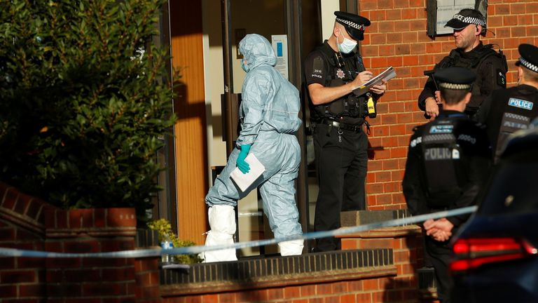 A member of the scientific police enters the scene where MP David Amess was stabbed during constituency surgery, in Leigh-on-Sea, Britain October 15, 2021. REUTERS/Andrew Couldridge