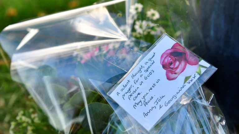 Flowers are laid down at the scene where MP David Amess was stabbed during constituency surgery, in Leigh-on-Sea, Britain October 15, 2021. REUTERS/Tony O'Brien